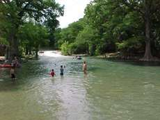 Swimming in the guadalupe River in Guene, Texas